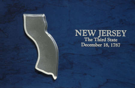 silver state: This is a silver map of the state of New Jersey against a blue background. It says, New Jersey, The Third State, December 18, 1787, which is the date it entered the Union.