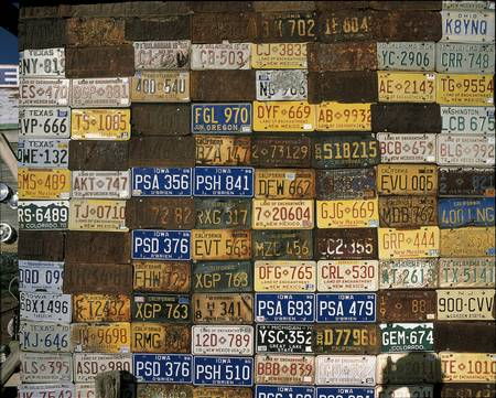 This is a wall of old license plates. It is a piece of roadside Americana. There are license plates from Texas, Iowa, New Jersey, California and other places.