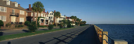 waterfront property: These are historic houses on Battery Street . They are next to the waterfront. They show the Southern living style in morning light.