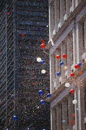 ticker: This is a Ticker Tape Parade showing the Desert Storm Victory Parade. It took place in the Canyon of Heroes where about 4.7 million people attended. This shows balloons and ticker tape.