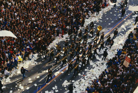 This is a marching band in a Ticker Tape Parade on Broadway and Wall Street. It took place in the Canyon of Heroes. There were about 2.2 million people who attended. It celebrated the Mets as the World Champions.
