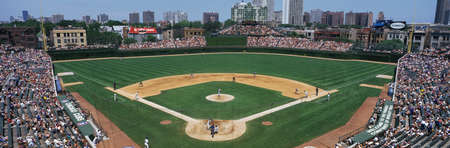 daytime: This is Wrigley Field. The Chicago Cubs are playing the Colorado Rockies. They played to a sold out crowd of 40,751. The final score was Cubs 7, Rockies 0.