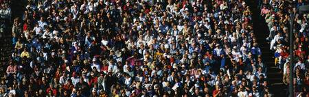 rose bowl parade: This is a crowd of people in the stands at the 109th Rose Bowl Parade on New Years Day.