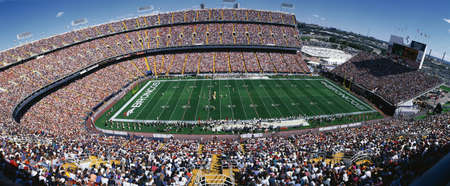This is Mile High Stadium with the Denver Broncos playing the St. Louis Rams to a sold out crowd. This was an NFL game that took place on 9/14/97. The final score was Denver 35, St. Louis 14.