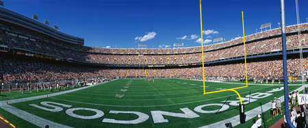 mile: This is Mile High Stadium and the game is the Denver Broncos vs. the St. Louis Rams. It is a sold out NFL game that took place on 91497.