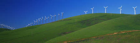 altamont pass: These are windmills along Route 580 at the Altamont Pass. It is a form of wind energy or alternative energy. It is springtime. Stock Photo