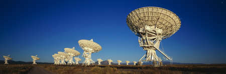 This is the Very Large Array or VLA at the National Radio Astronomy Observatory. It represents communication. photo
