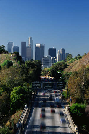 briskness: This is morning rush hour traffic on the Pasadena Freeway. It is near Dodger Stadium with the skyline in the background.