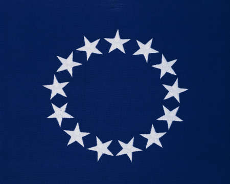 colonial: This is a flag with 13 stars sewn in a circle in a field of blue. This was the Original Colonial Flag from the Revolutionary War.
