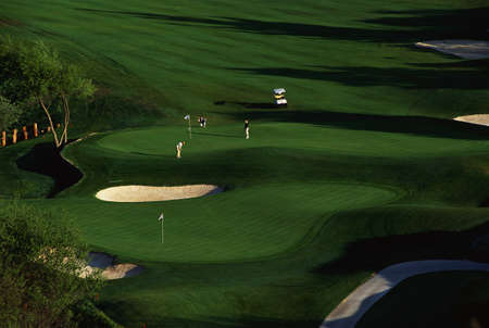 These are golfers approaching the green at Carmel Valley Ranch Golf Course, designed by Pete Dye, in Carmel, California.