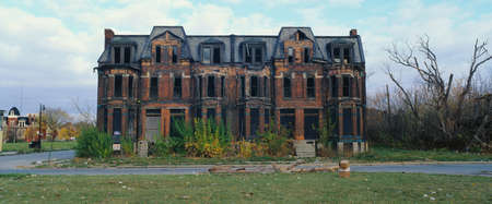 abandoned house: This is a deserted building in a bad part of town. It shows the urban wasteland of Detroit.