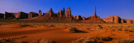bi: This is Yei Bi Chei and The Totem Pole at sunrise. In front are the sand dunes of Monument Valley.