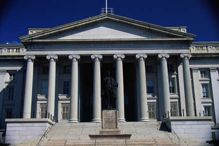 public spirit: This is the U.S. Department of Treasury with its statue of Alexander Hamilton in front. Stock Photo