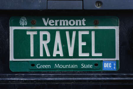 license plate: This is a vanity license plate that says TRAVEL. It is a green Vermont license plate. Vermont is the Green Mountain State. Editorial
