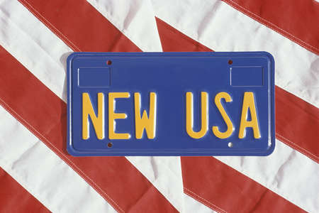 license plate: New USA license plate on stripes of American flag Stock Photo