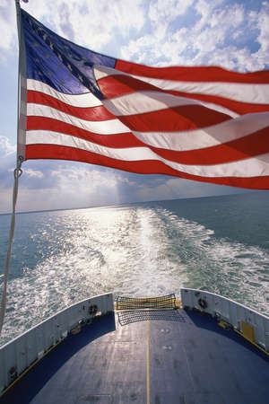 American flag waving on ship photo