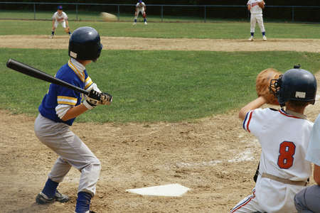 diversion: Young batter preparing to hit baseball