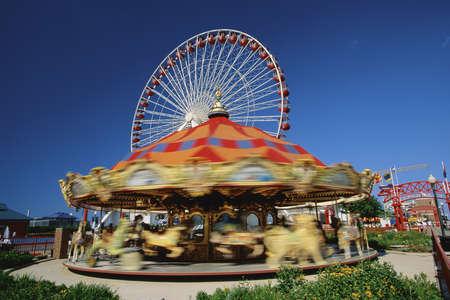 Carousel at amusement park in evening Editorial