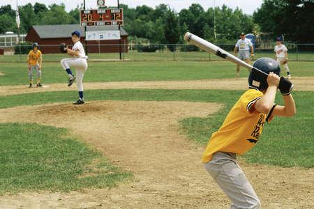 Little League batter awaiting pitch