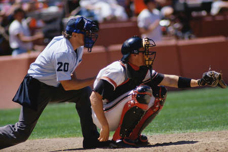 an umpire: Baseball catcher and umpire at game Editorial