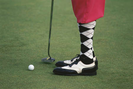 Socks and shoes of golfer
