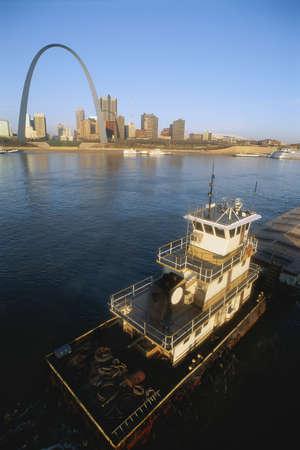 mississippi river: Barge on Mississippi River, St. Louis beyond