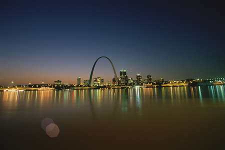 St. Louis at night, reflecting on water