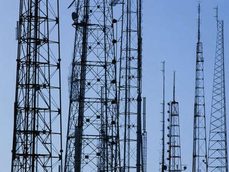 Silhouetted TVradio antennas Stock Photo
