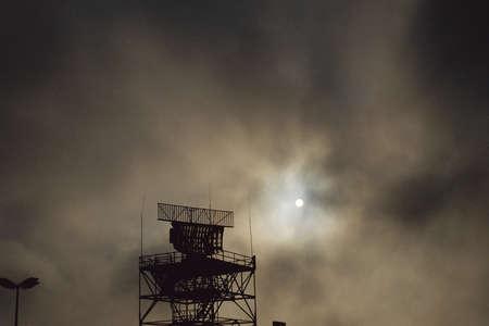 Air traffic control antenna against stormy sky