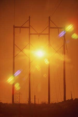 Power lines with sunburst