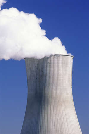 billowing: Steam billowing from nuclear power plant reactor