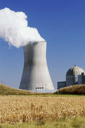 nuclear reactor: Nuclear reactor with farmland in foreground Stock Photo