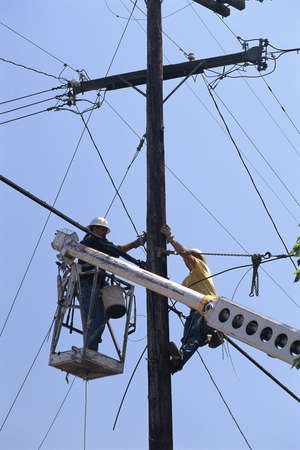 linemen: Cable TV Linemen at work Stock Photo