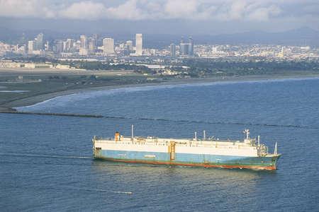 Cargo ship departing San Diego port photo