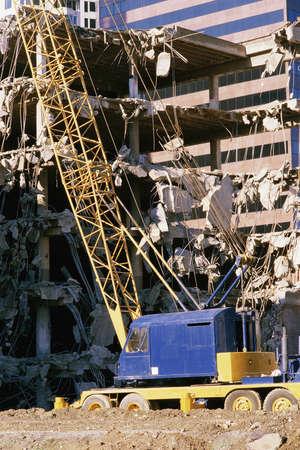 deconstruct: Crane in building deconstruction site