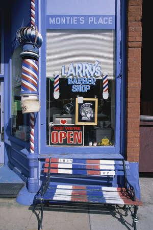 Storefront of Larrys Barber Shop, CO