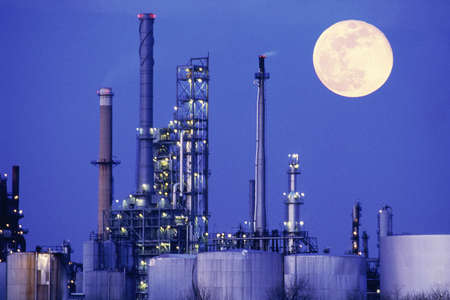 Chemical manufacturing plant with full moon
