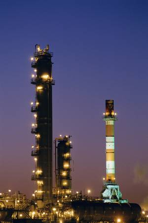 Oil refinery at night photo