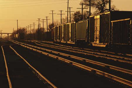 boxcar train: Railroad cars on tracks