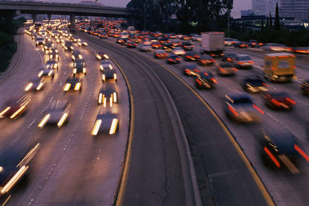 congested: Heavy traffic on freeway at twilight