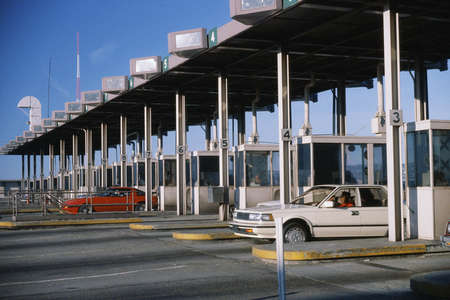 toll: Cars emerging from toll booth Editorial