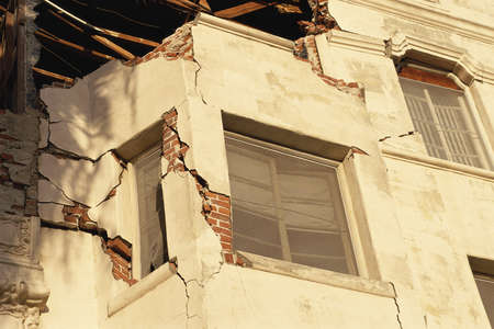 earthquake crack: Building with broken walls and windows