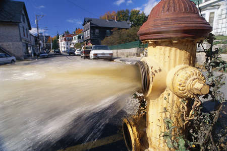 wasteful: Open fire hydrant shooting water