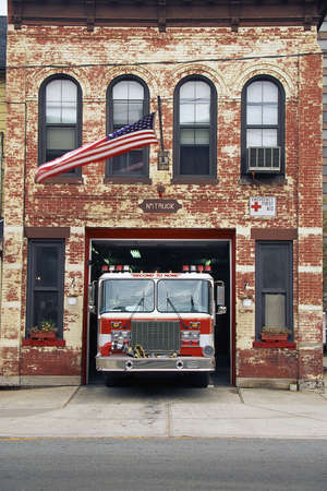 visions of america: Fire engine parked in firehouse