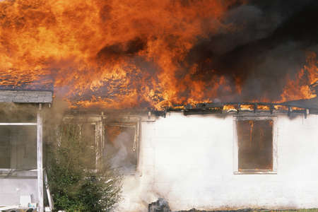 house fire: Raging house fire Stock Photo
