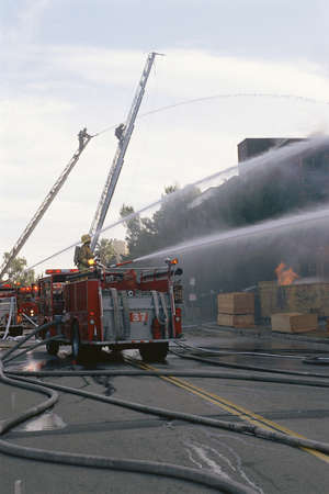 Firefighters dousing building