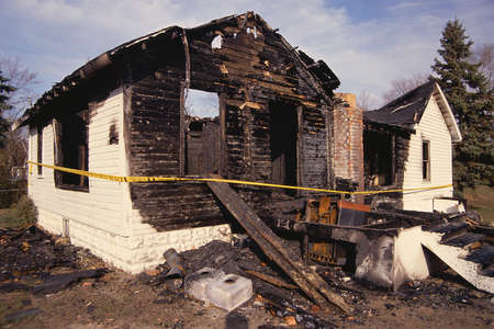 gutted: Charred house and rubble