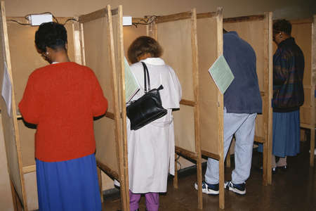 voting: Voters selecting candidates in voting booths