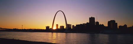 Gateway Arch and St. Louis at dawn Editorial