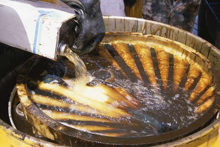 hazardous waste: Hazardous waste being poured into steel container